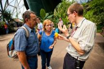 An Eden Project employee giving to people a guided tour